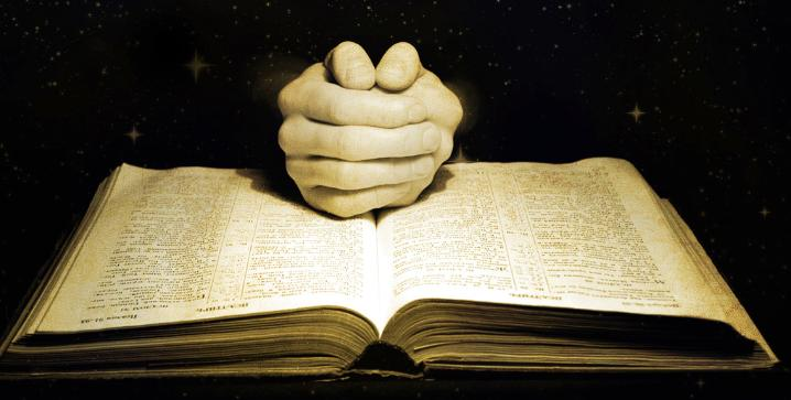 hands on the bible